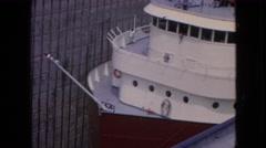 1964: huge ship standing on shore white maintenance fence around NIAGRA FALLS Stock Footage