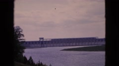 1964: large reservoir of a dam with islands of grass under the clear sky  Stock Footage