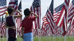 Children saluting flags Stock Footage