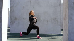 Fitness woman doing lunges Stock Footage