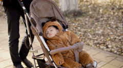 Parents walks in the city in the warm autumn weather with the child Stock Footage