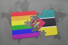 Puzzle with the national flag of mozambique and gay rainbow flag on a world m Stock Photos