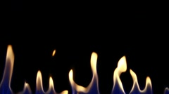 Isolated flame on black Stock Footage