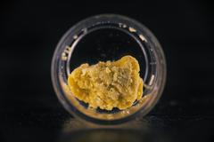 Cannabis extraction wax crumble isolated Stock Photos