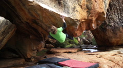 A man bouldering rock climbing. Stock Footage