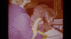 1965: woman and her dog friend. WELLSBURG IOWA Stock Footage