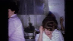 1965: group of people smoking, drinking and enjoying around a table WELLSBURG Stock Footage