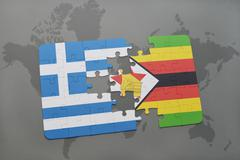 Puzzle with the national flag of greece and zimbabwe on a world map backgroun Stock Photos
