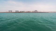Boat tracking shot from the mediterranean sea of herzliya marina in israel Stock Footage