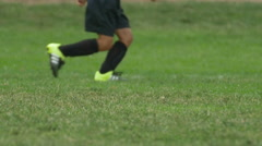Boys playing youth soccer football, slow motion. Stock Footage