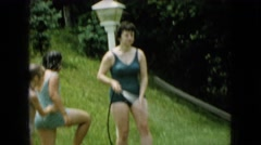1965: family playing outside with a hose WELLSBURG IOWA Stock Footage