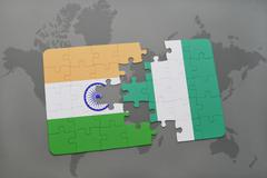 Puzzle with the national flag of india and nigeria on a world map background. Kuvituskuvat