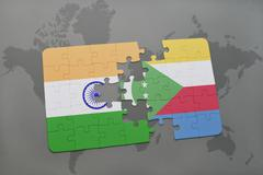 Puzzle with the national flag of india and comoros on a world map background. Stock Photos