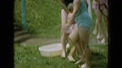 1965: children playing in water outdoors during summer WELLSBURG IOWA Stock Footage