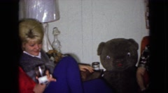 1965: old school cool video of friends enjoying a few drinks with shaggy dog Stock Footage
