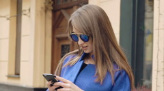 Happy woman speaking on the mobile phone on the street Stock Footage
