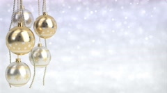 Golden and silver christmas balls with bokeh background. Seamless loop. 3D Stock Footage