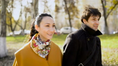Couple in a wonderful mood to walks in the autumn city. As long  the baby is Stock Footage