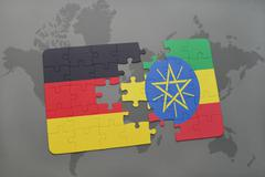 Puzzle with the national flag of germany and ethiopia on a world map backgrou Stock Photos