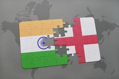 Puzzle with the national flag of india and england on a world map background. Stock Photos