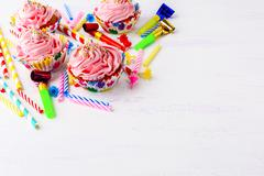 Birthday party background with pink buttercream frosting cupcakes Stock Photos