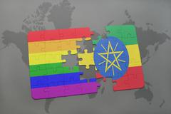 Puzzle with the national flag of ethiopia and gay rainbow flag on a world map Kuvituskuvat