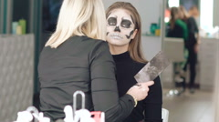 Apply make-up the girl in the form of skull Stock Footage