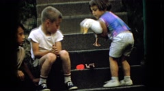 1965: small child carries live domestic duck to show friends. WELLSBURG IOWA Stock Footage