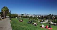 Dolly Establishing Shot People Enjoying Mission Dolores Park in San Francisco  	 Stock Footage
