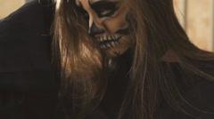 Sexy devilish female vampire flirting with the camera Stock Footage