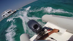 POV of a man steering an outboard engine in an inflatable boat in the Red Sea, E Stock Footage