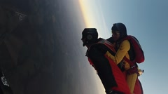 Two skydivers free falling in sky together. Speed. Extreme activity. Sunset Stock Footage