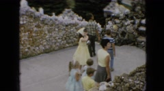 1967: children visiting place looking sculptures architecture  Stock Footage