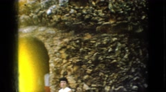1967: people visiting a rock garden with amazing colors and shapes IOWA Stock Footage