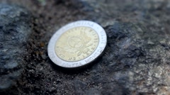 Finding a Coin on the Street Stock Footage