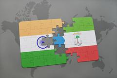 Puzzle with the national flag of india and equatorial guinea on a world map b Stock Photos