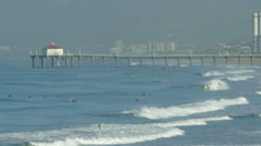 The Manhattan Beach Pier in California extends into the Pacific Ocean, slow moti Stock Footage