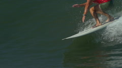 A male surfer rides a wave and gets tubed on a longboard surfboard, slow motion. Stock Footage
