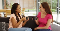 4k, Two pretty friends enjoying a light-hearted conversation Stock Footage