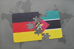 Puzzle with the national flag of germany and mozambique on a world map backgr Stock Photos