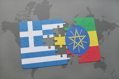 Puzzle with the national flag of greece and ethiopia on a world map backgroun Stock Photos