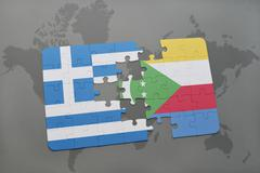 Puzzle with the national flag of greece and comoros on a world map background Stock Photos