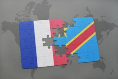 Puzzle with the national flag of france and democratic republic of the congo Stock Photos