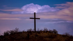 Looping time lapse video of cross on a hill with lightning in the background Stock Footage