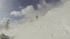A man goes cross-country skiing on a very windy day, slow motion. Stock Footage