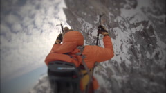A man is speed flying riding above the snowy mountains, slow motion. Stock Footage