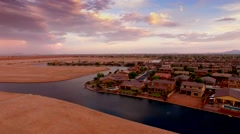 4K Drone Aerial Desert Suburb Cloudy Sunset Push In Dramatic Waterfront Homes Stock Footage