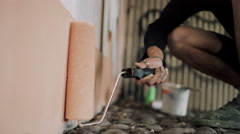 4K Close up on hand of graffiti artist using paint roller to create artwork Stock Footage