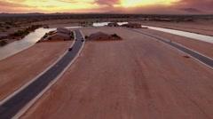 4K Drone Aerial Desert Suburb Sunset Tilt Up Reveal Dust Storm Boy on Bike Stock Footage