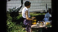 1969: family outdoor picnic together many couples sitting talk CALIFORNIA Stock Footage